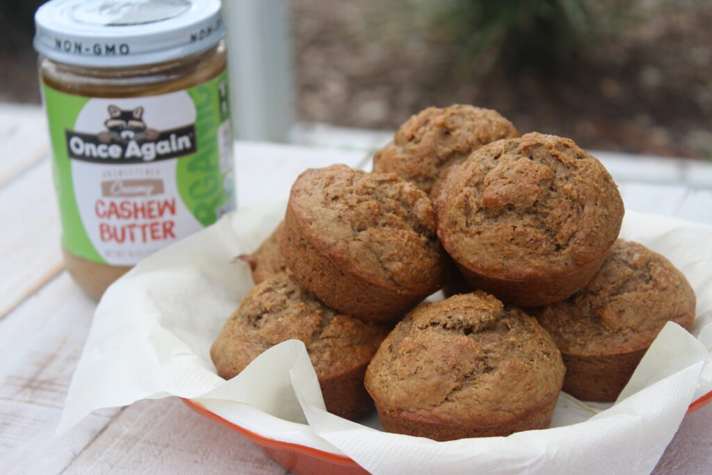Brown Sugar Cinnamon Muffins with jar of Cashew butter